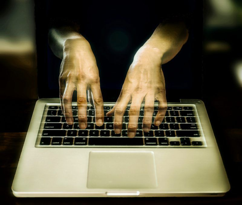 Hacker Typing on a Laptop