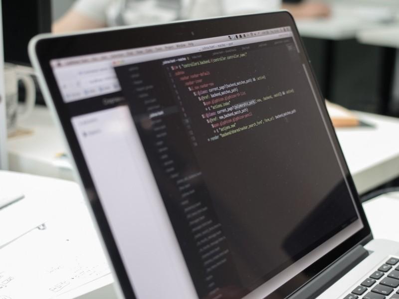 laptop screen displaying source code