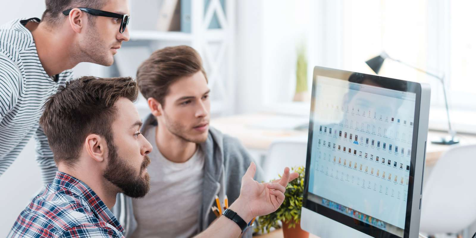 Developers Collaborating Around a Screen